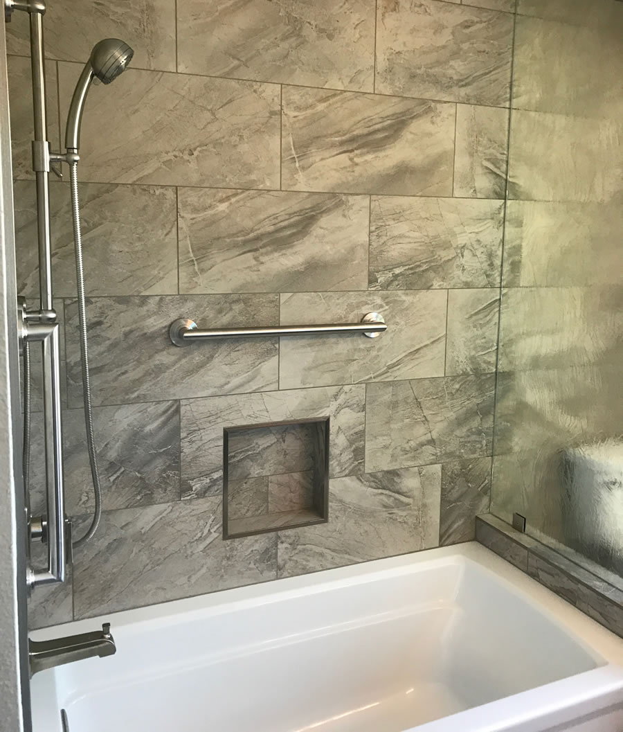 Bath with large tiles